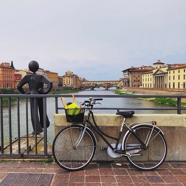 "[Art walk with Valentina] To the left is @cletabraham's Common Man that was taken down in 2011 after it was installed without permission. It was re-installed last year giving us the opportunity to pass by it and think ""what will you risk today?""#valentinalabici #clet #pontevecchio #florence"